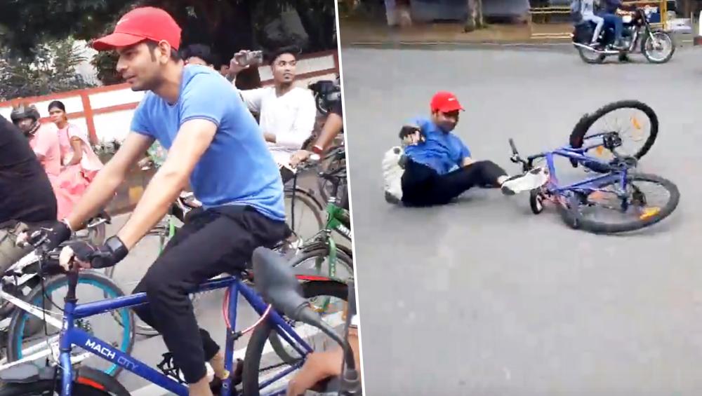 VIDEO: विरोध प्रदर्शन के दौरान साइकिल चलाते समय गिरे तेजप्रताप यादव