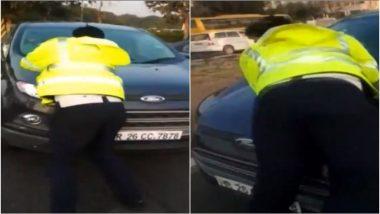 VIDEO: गुरुग्राम में चालान से बचने के लिए ड्राइवर ने की भागने की कोशिश, कार की बोनट पर कूदे सिपाही को घसीटा
