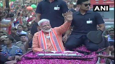लोकसभा चुनाव 2019: पीएम मोदी के रोड शो में भगवामय हुई काशी, सड़कों पर उमड़ा जनसैलाब