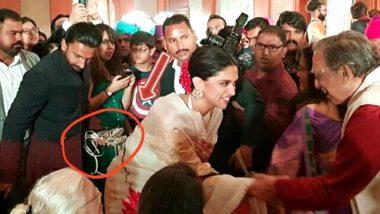 शादी में रणवीर सिंह ने उठाए दीपिका पादुकोण के सैंडल, सोशल मीडिया पर वायरल हो रही है ये तस्वीर