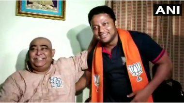 पश्चिम बंगाल: बीजेपी उम्मीदवार अनुपम हाजरा ने TMC नेता के छुए पैर, पार्टी ने मांगा स्पष्टीकरण