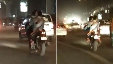 दिल्ली में कपल ने चलती बाइक पर की अश्लील हरकत, पुलिस अफसर ने की नए ट्रैफिक नियमों की मांग, वीडियो हुआ वायरल