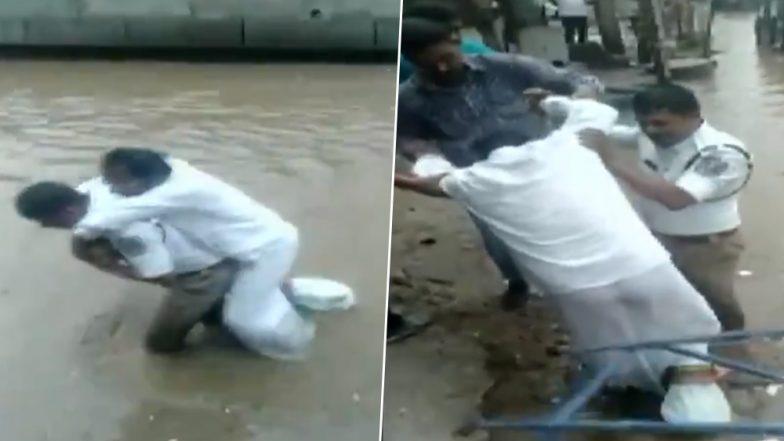 हैदराबाद में ट्रैफिक इंस्पेक्टर ने पेश की मानवता की मिसाल, 'बेबस' शख्स को पीठ पर उठाकर पानी से भरी सड़क पार करवाई, देखें Video