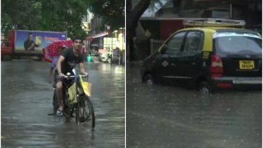 Mumbai Rains: रविवार को भी जारी है भारी बारिश, सड़कों पर जमा पानी, रेल-बस सेवा प्रभावित
