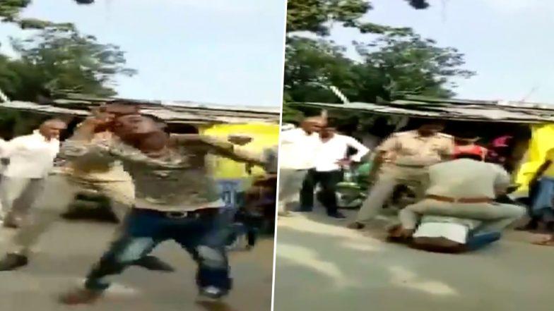 Video: बाइक सवार ने किया ट्रैफिक नियमों का उल्लंघन, दो पुलिसकर्मियों ने लात-घूंसों से की पिटाई, यूपी पुलिस ने की ये कार्रवाई