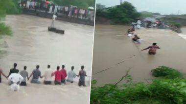 इंदौर: पानी में बह रहे लोगों को बचाने के लिए सैकड़ों लोगों ने बनाया ह्यूमन चैन, देखें VIDEO
