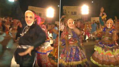गुजरात: सूरत में लोगों ने पीएम मोदी का मास्क पहनकर खेला गरबा, देखें वीडियो