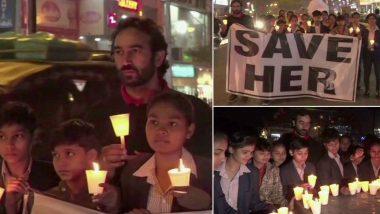हैदराबाद गैंगरेप मामला: रोहतक में पूर्व हॉकी खिलाड़ी अजीत पाल नांदल ने अपनी छात्राओं के साथ निकाला कैंडल मार्च