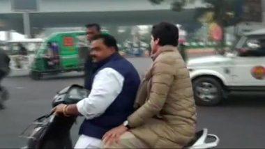 कांग्रेस पार्टी के कार्यकर्ता को बिना हेलमेट प्रियंका गांधी को यात्रा कराना पड़ा महंगा, पुलिस ने काटा 6100 रु. का चालान