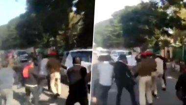असम के सीएम सर्बानंद सोनोवाल के काफिले को AASU के सदस्यों ने दिखाए काले झंडे, वायरल हुआ Video