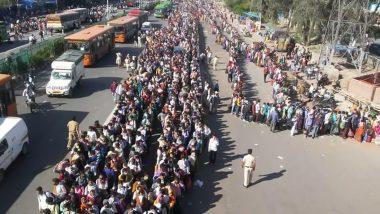 दिल्ली: लॉकडाउन के दौरान आनंद विहार बस स्टैंड पर जमी भीड़, घर जाने को उमड़े हजारों लोग- देखें VIDEO