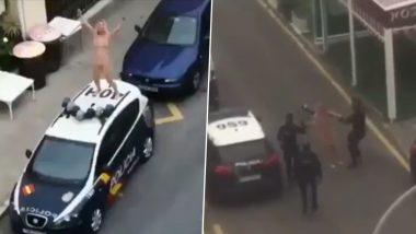 Coronavirus: लॉकडाउन से परेशान स्पैनिश महिला ने NUDE होकर किया हंगामा, पुलिस की कार पर चढ़ी