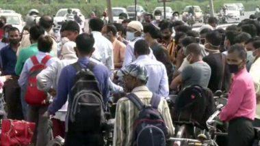 कोरोना संकट के चलते हरियाणा ने सील किए सभी बॉर्डर, दिल्ली-गुरुग्राम सीमा पर लगा लोगों का जमावड़ा- देखें तस्वीरें