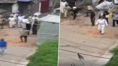 Cyclone Amphan: 'अम्फान' चक्रवात के बाद दो बस्तियों के लोगों के बीच हुई हिंसक झड़प, पुलिस ने भीड़ को किया तितर-बितर (Watch Video)