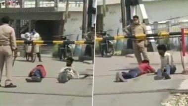 उत्तर प्रदेश: हापुड में दो मजदूरों को रेलवे फाटक के पास जमीन पर रोल करवाते दिखे 2 पुलिसकर्मी, वीडियो वायरल होने पर हुई कार्रवाई