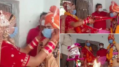 कोरोना संकट के बीच राजस्थान में दुल्हा-दूल्हन ने मास्क पहनकर लिए सात फेरे, सोशल डिस्टेंसिंग का पालन करते हुए एक-दूसरे को पहनाई वरमाला