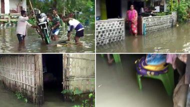 असम: भारी बारिश से लोगों का हाल बेहाल, आवासीय क्षेत्रों में घुसा बाढ़ का पानी, देखें तस्वीर