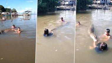 Shocking! नदी में मगरमच्छ के साथ खेलते बच्चों का वीडियो हुआ वायरल, देखकर आप भी हो जाएंगे हैरान (Watch Video)