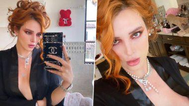 Bella Thorne Teases Insta Fans: सेक्स वर्कर्स के साथ XXX Website कंट्रोवर्सी के बाद बेला थोर्न ने OnlyFans पेज प्रमोट करने के लिए ब्लैक सैटिन रॉब में दिखाया क्लीवेज, देखें तस्वीरें