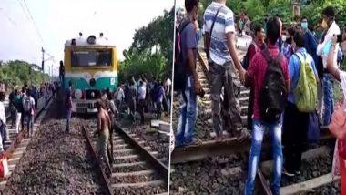 Kolkata: लोगों ने सभी के लिए ट्रेन सेवाओं की मांग के लिए किया आंदोलन, रेलवे ट्रैक किया ब्लॉक