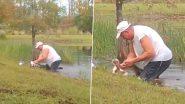 Man Rescue Puppy From Alligator: मगरमच्छ के जबड़े से अपने पालतू कुत्ते को बचाने के लिए तालाब में कूदा शख्स, वीडियो हुआ वायरल