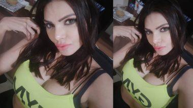 Sherlyn Chopra Hot Photo: शर्लिन चोपड़ा की इस हॉट ड्रेस को देखकर हो जाएंगे कंफ्यूज, फोन छिपाकर देखें एडल्ट फोटो