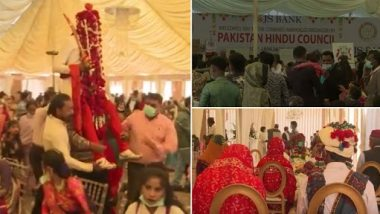 Video: पाकिस्तान में लगभग 50 हिंदू जोड़े कराची में एक सामूहिक विवाह में शादी के बंधन में बंधे