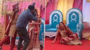 Viral Video: शादी में फोटोशूट के दौरान दूल्हे ने कैमरामैन को लगाया कंटाप, दुल्हन हंसते हंसते जमीन पर हुई लोटपोट