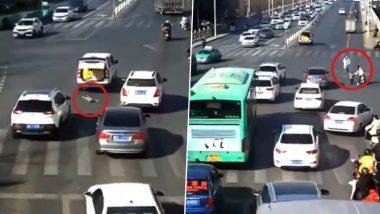 OMG! व्यस्त सड़क पर चलती कार से गिरा बच्चा, Viral Video में देखें कैसे बाल-बाल बची उसकी जान