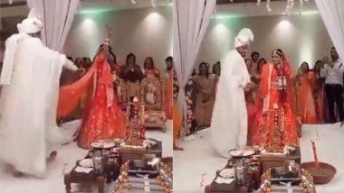 शादी में फेरों के समय खुशी से नाचने लगे दूल्हा-दुल्हन, यूजर्स बोले- यह भारतीय परंपराओं का अनादर (Watch Viral Video)