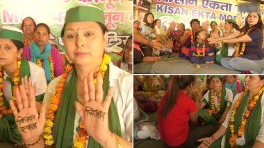 Farmers Protests: गाज़ीपुर बॉर्डर पर विरोध में प्रदर्शन में शामिल होने पहुंची महिलाएं, एक दूसरे को मेहंदी लगाकर दिखाई अपनी एकजुटता