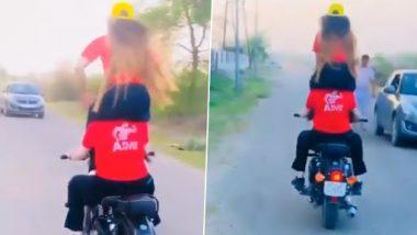 Ghaziabad Viral Video: कंधे पर लड़की को बैठाकर इस महिला ने चलाया बुलेट, जानलेवा स्टंट देखकर उड़ जाएंगे होश