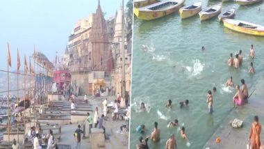 Uttar Pradesh: अक्षय तृतीया के अवसर पर श्रद्धालुओं ने वाराणसी में गंगा नदी में स्नान किया