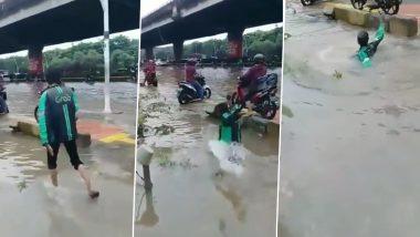 सावधानी हटी दुर्घटना घटी! पानी से लबालब भरी सड़क पर मोबाइल देखकर चलना शख्स को पड़ा भारी, नाले में गिरा धड़ाम से… (Watch Viral Video)