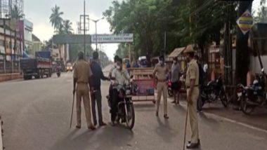 कर्नाटक में 7 जून तक जारी रहेगा लॉकडाउन, हुबली में वाहनों की जांच करते दिखे पुलिसकर्मी
