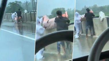 Viral Video: यूपी के बलरामपुर में COVID मरीज के शव को राप्ती नदी में फेंकने वाले 2 लोगों का चौंकाने वाला वीडियो वायरल
