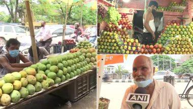 Assam: कोविड लॉकडाउन की वजह से आम के विक्रेताओं को उठाना पड़ रहा है नुकसान, देखें तस्वीर