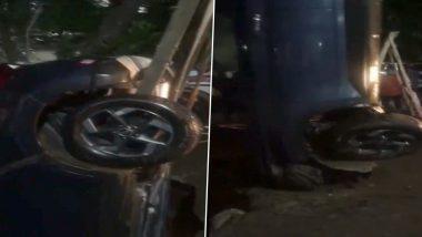 मुंबई के घाटकोपर में सिंकहोल में समाई कार को क्रेन की मदद से बाहर निकाला गया- देखें वीडियो