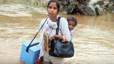 Viral Pic: हाथ में वैक्सीन कंटेनर, पीठ पर बच्चे को लेकर नदी पार करती स्वास्थ्यकर्मी की तस्वीर हुई वायरल, महिला के जज्बे को लोगों ने किया सलाम