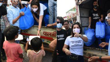 Sunny Leone ने पति डेनियल वेबर के साथ मिलकर जरूरतमंदो में बांटे खाने के पैकेट, देखिए Photos