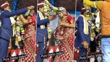 Viral Video: दूल्हा, दुल्हन के सिर में उलझी शादी की माला, जयमाला का फनी वीडियो हुआ वायरल