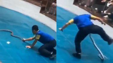 किंग कोबरा को पकड़कर तमाशा दिखाना सपेरे को पड़ा महंगा, गुस्से में सांप ने शक्स के प्राइवेट पार्ट पर किया हमला (Watch Viral Video)