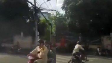सावधानी हटी, दुर्घटना घटी! फोन पर बात करते हुए स्कूटी चला रहे शख्स के साथ हुआ कुछ ऐसा… (Watch Viral Video)