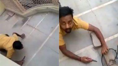 गाजियाबाद: कटियाबाज के यहां बिजली विभाग का छापा, अवैध कनेक्शन को काटने के लिए सांप की तरह रेंगते हुए पहुंचा शख्स (Watch Viral Video)