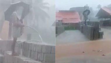 Viral Video: तेज बारिश में छाता लेकर ईंट पर पानी डालते इस शख्स को देख चकरा जाएगा आपका सिर, मजेदार वीडियो हुआ वायरल