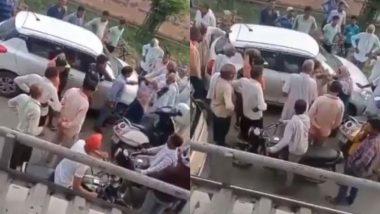 बीच सड़क पर महिला ने कर दी कार चालक की पिटाई, सोशल मीडिया पर वायरल हुआ हैरान करने वाला वीडियो (Watch Viral Video)