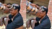 Desi Jugaad Video: सिर के बाल काटने के लिए शख्स ने किया घास काटने की मशीन का इस्तेमाल, उसके जुगाड़ को देख हैरान हुए लोग